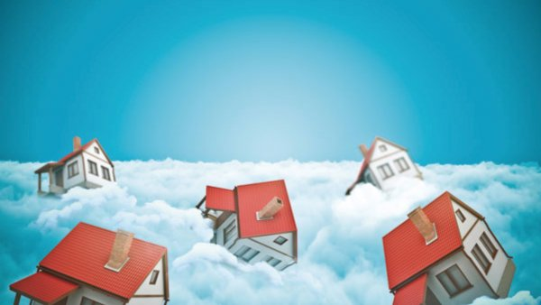 Illustration of houses on top of clouds